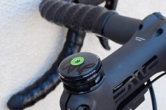 Tune carbon top cap. Carbon-ti bolt. Enve stem with black ti bolts.